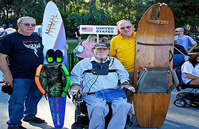Royce Andes (center) is the creator of the first adaptive water ski, shown on the right, along with his friend and ski fabricator.  On the left is Liquid Access's Lee Hester with one of our skis belonging to competitive skier, Mark Turner.